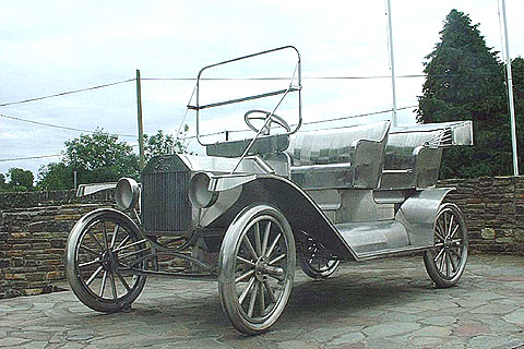 There is a sculpture of a Model T in Ballinacarthy, County Cork, Ireland, Henry Ford's father came from here, to commemorate Ford's 100th anniversary in 2003. The last Model T was produced anywhere in Cork in December 1928.