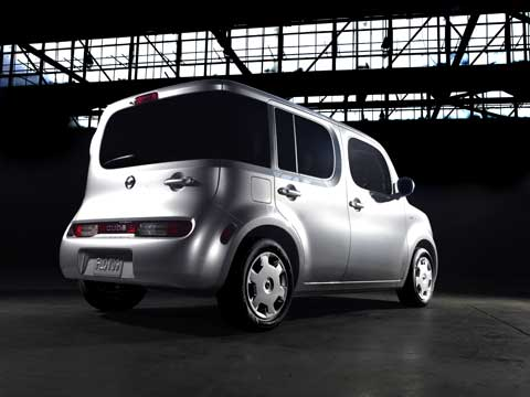 The Nissna Cube unique, non-traditional design features an asymmetrical body, a stout �bulldog-like� stance, wide doors, a large greenhouse with wraparound rear window, and a refrigerator-style rear door